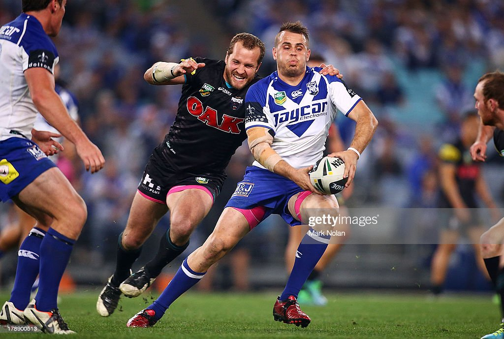 Josh Reynolds of the Bulldogs looks to pass during the round 25 NRL match between the Canterbury Bulldogs and the Penrith Panthers at ANZ Stadium on August 31, 2013 in Sydney, Australia.