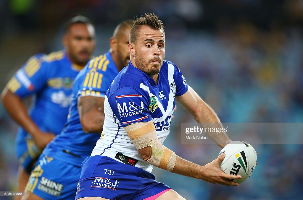 Josh Reynolds of the Bulldogs looks to pass during the round nine NRL match between the Parramatta Eels and the Canterbury Bulldogs at ANZ Stadium on April 29, 2016 in Sydney, Australia.
