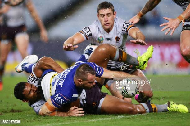 Josh Reynolds of the Bulldogs reaches out to score during the round five NRL match between the Canterbury Bulldogs and the Brisbane Broncos at ANZ...