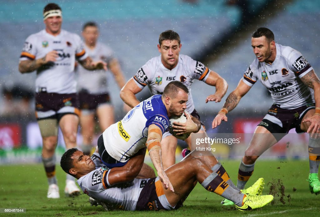 Josh Reynolds of the Bulldogs reaches out to score during the round five NRL match between the Canterbury Bulldogs and the Brisbane Broncos at ANZ Stadium on March 30, 2017 in Sydney, Australia.