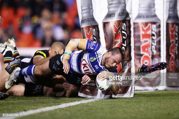 Josh Reynolds of the Bulldogs scores a try during the round 21 NRL match between the Penrith Panthers and the Canterbury Bulldogs at Pepper Stadium...