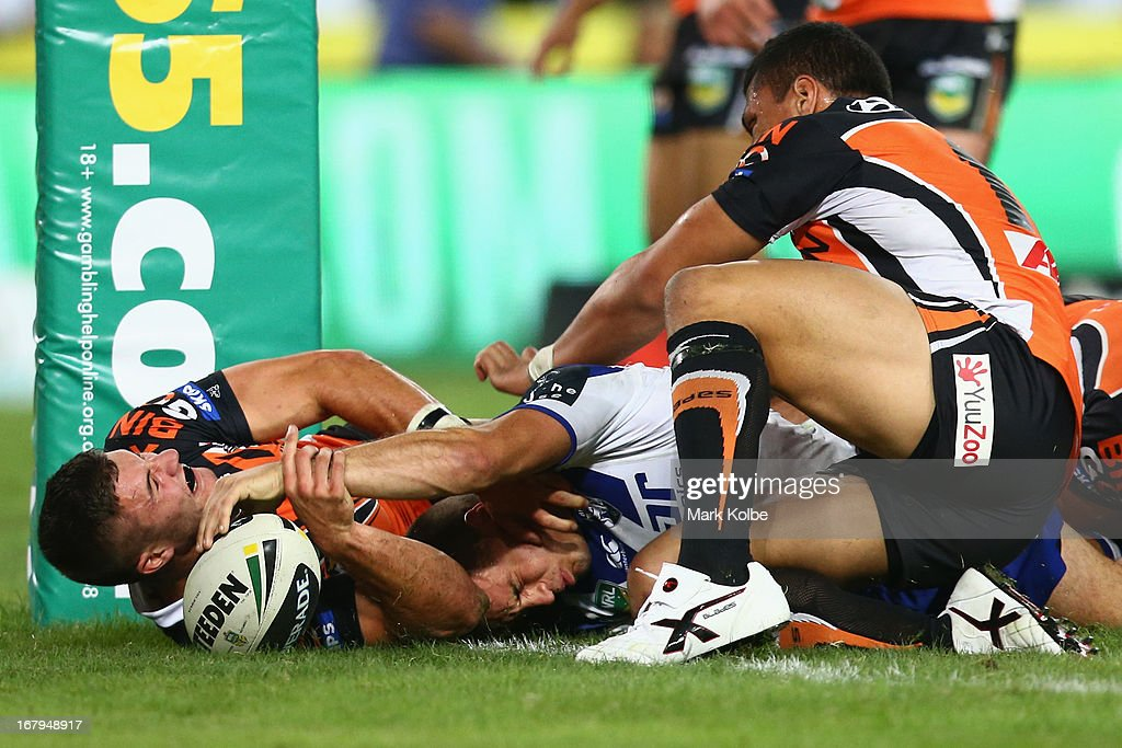 Josh Reynolds of the Bulldogs scores a try during the round eight NRL match between the Bulldogs and the Wests Tigers at ANZ Stadium on May 3, 2013 in Sydney, Australia.