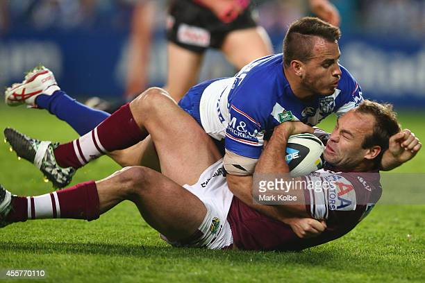 Josh Reynolds of the Bulldogs tackles Brett Stewart of the Sea Eagles during the NRL 2nd Semi Final match between the Manly Sea Eagles and the...