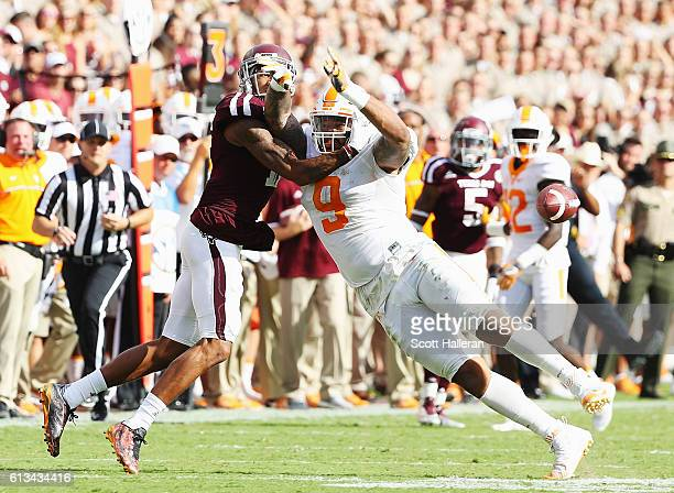 Josh Reynolds of the Texas AM Aggies and Derek Barnett of the Tennessee Volunteers battle for the football during their game at Kyle Field on October...