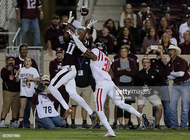 Josh Reynolds of the Texas AM Aggies catches a 13 yard pass for a touchdown as Jaylon Jones of the Mississippi Rebels is unable to knock the ball...