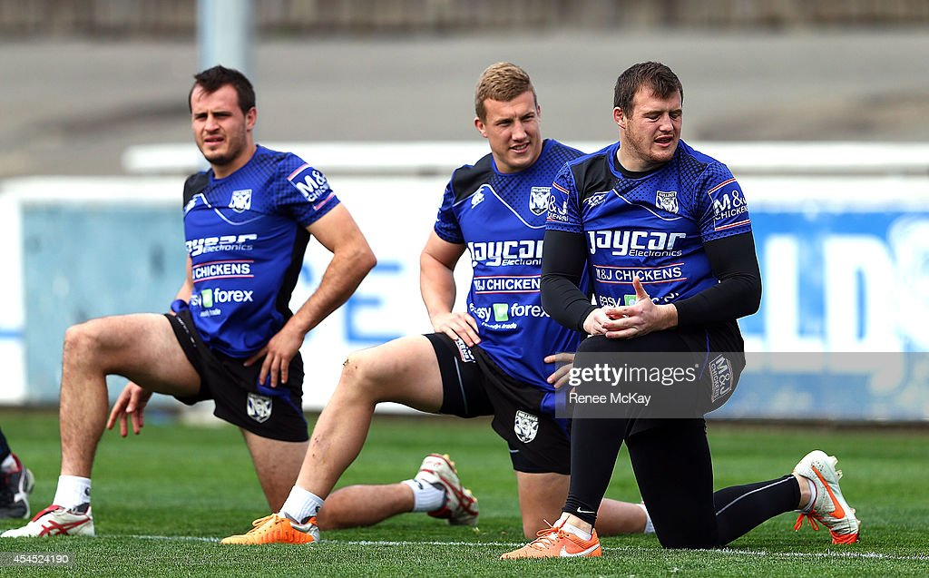 Josh Reynolds; <a gi-track='captionPersonalityLinkClicked' href=/galleries/search?phrase=Trent+Hodkinson&family=editorial&specificpeople=6735301 ng-click='$event.stopPropagation()'>Trent Hodkinson</a> and <a gi-track='captionPersonalityLinkClicked' href=/galleries/search?phrase=Josh+Morris+-+Rugby+Player&family=editorial&specificpeople=10980783 ng-click='$event.stopPropagation()'>Josh Morris</a> stretch during a Canterbury Bulldogs NRL training session at Belmore Sports Ground on September 3, 2014 in Sydney, Australia.