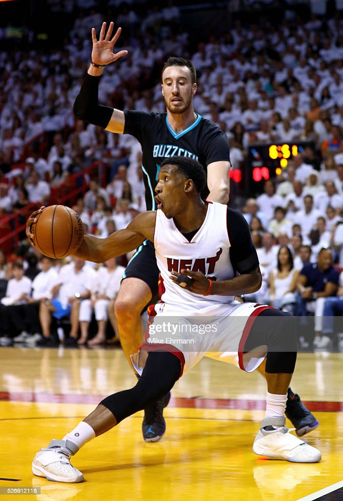 Josh Richardson #0 of the Miami Heat drives on Frank Kaminsky III #44 of the Charlotte Hornets during Game Seven of the Eastern Conference Quarterfinals of the 2016 NBA Playoffs at American Airlines Arena on May 1, 2016 in Miami, Florida.