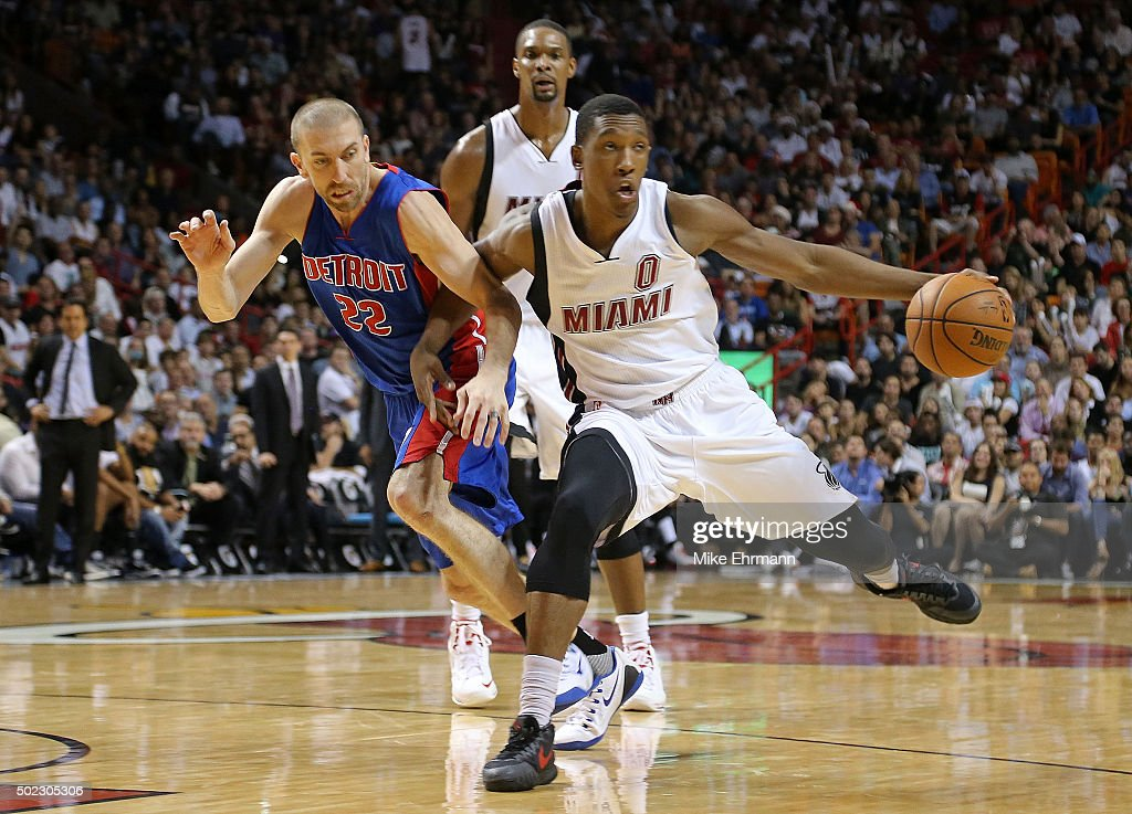 Josh Richardson #0 of the Miami Heat drives on Steve Blake #22 of the Detroit Pistons during a game at American Airlines Arena on December 22, 2015 in Miami, Florida.