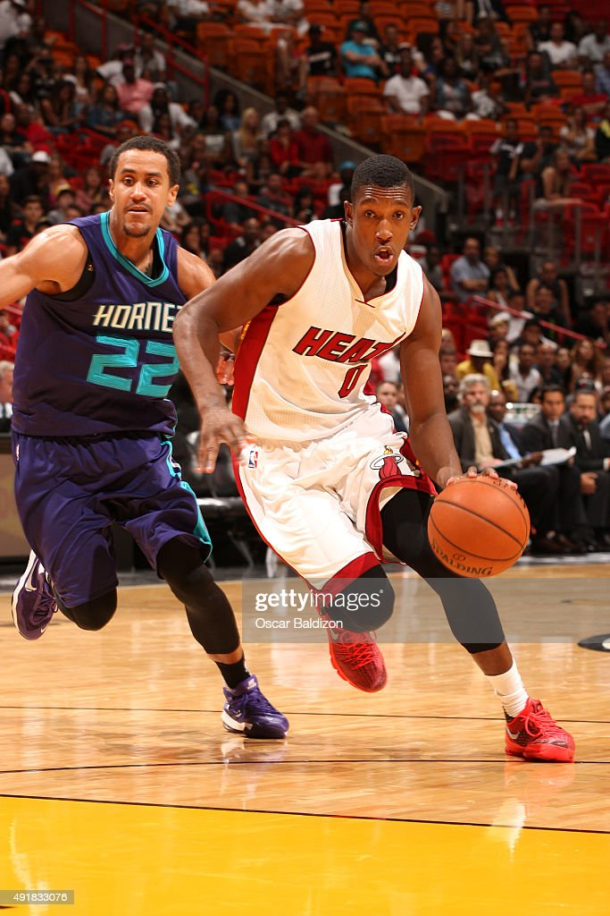 Josh Richardson #0 of the Miami Heat drives to the basket against the Charlotte Hornets at the American Airlines Arena in Miami, Florida on October 4, 2015.