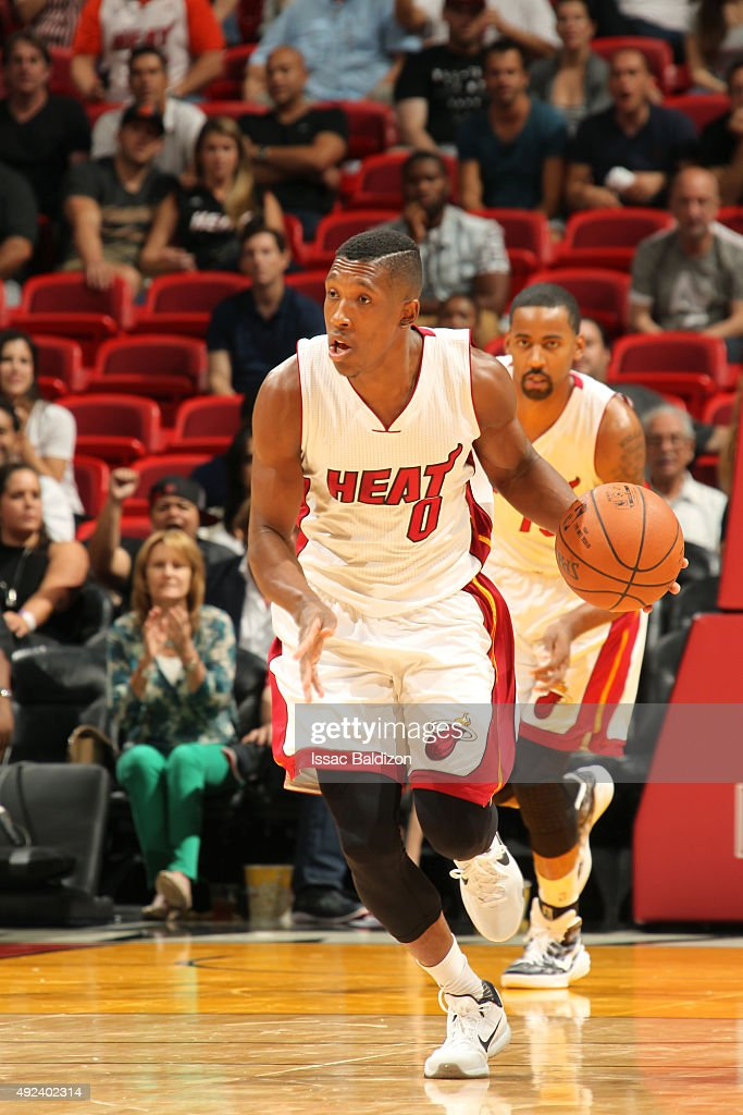 <a gi-track='captionPersonalityLinkClicked' href=/galleries/search?phrase=Josh+Richardson+-+Basketballer&family=editorial&specificpeople=14718165 ng-click='$event.stopPropagation()'>Josh Richardson</a> #0 of the Miami Heat drives to the basket against the San Antonio Spurs during a preseason game on October 12, 2015 at AmericanAirlines Arena in Miami, Florida.