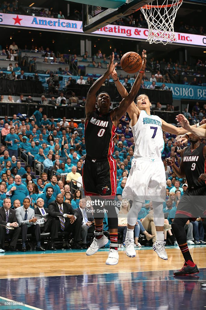 Josh Richardson #0 of the Miami Heat grabs the rebound against Jeremy Lin #7 of the Charlotte Hornets in Game Six of the Eastern Conference Quarterfinals during the 2016 NBA Playoffs on April 29, 2016 at Time Warner Cable Arena in Charlotte, North Carolina.