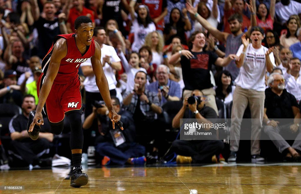 Josh Richardson #0 of the Miami Heat reacts to a three pointer during a game against the Cleveland Cavaliers at American Airlines Arena on March 19, 2016 in Miami, Florida.