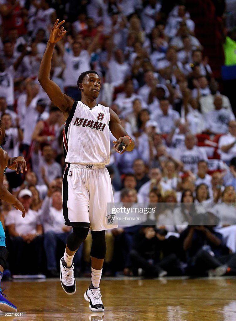 Josh Richardson #0 of the Miami Heat reacts to a three pointer during game two of the Eastern Conference Quarterfinals of the 2016 NBA Playoffs against the Charlotte Hornets at American Airlines Arena on April 20, 2016 in Miami, Florida.