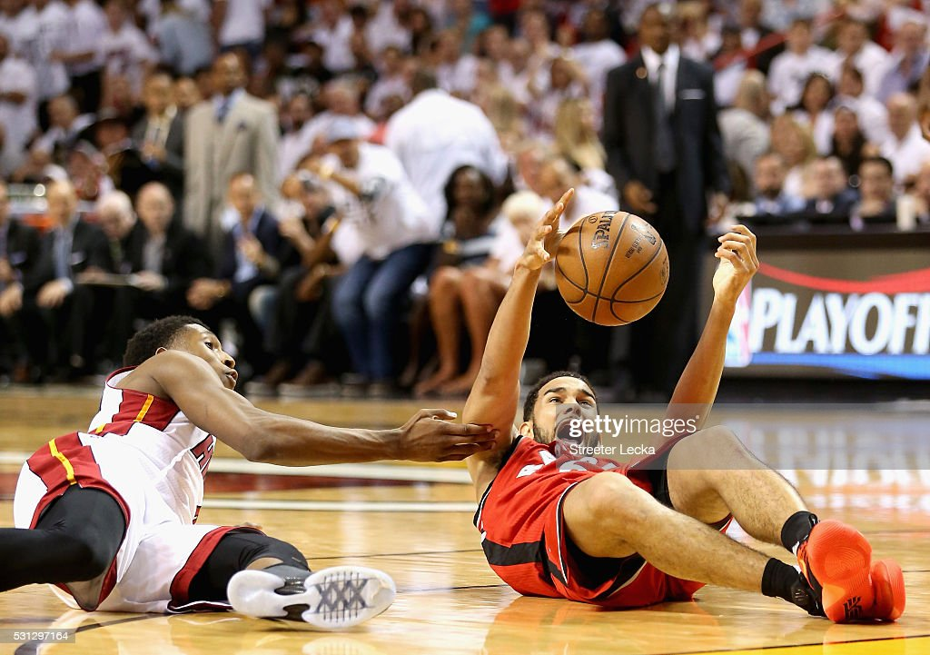 Josh Richardson #0 of the Miami Heat tries to grab a loose ball against Cory Joseph #6 of the Toronto Raptors during Game 6 of the Eastern Conference Semifinals of the 2016 NBA Playoffs at American Airlines Arena on May 13, 2016 in Miami, Florida.