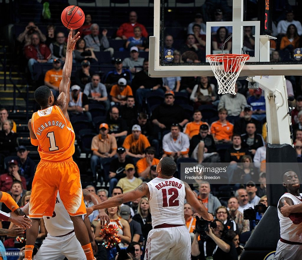 Josh Richardson #1 of the University of Tennessee Volunteers takes a shot over Trevor Releford #12 of the Alabama Crimson Tide during the Quarterfinals of the SEC Tournament at the Bridgestone Arena on March 15, 2013 in Nashville, Tennessee.