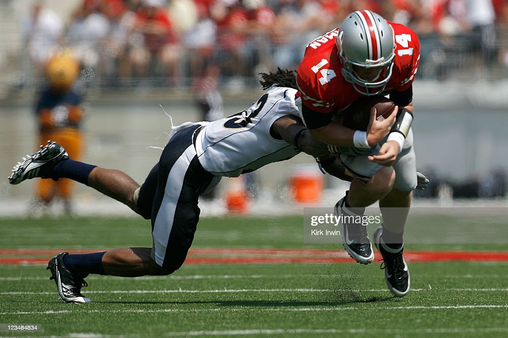 Josh Richmond #33 of the Akron Zips tackles Joe Bauserman #14 of the Ohio State Buckeyes during the second quarter on September 3, 2011 at Ohio Stadium in Columbus, Ohio. Ohio State defeated Akron 42-0.