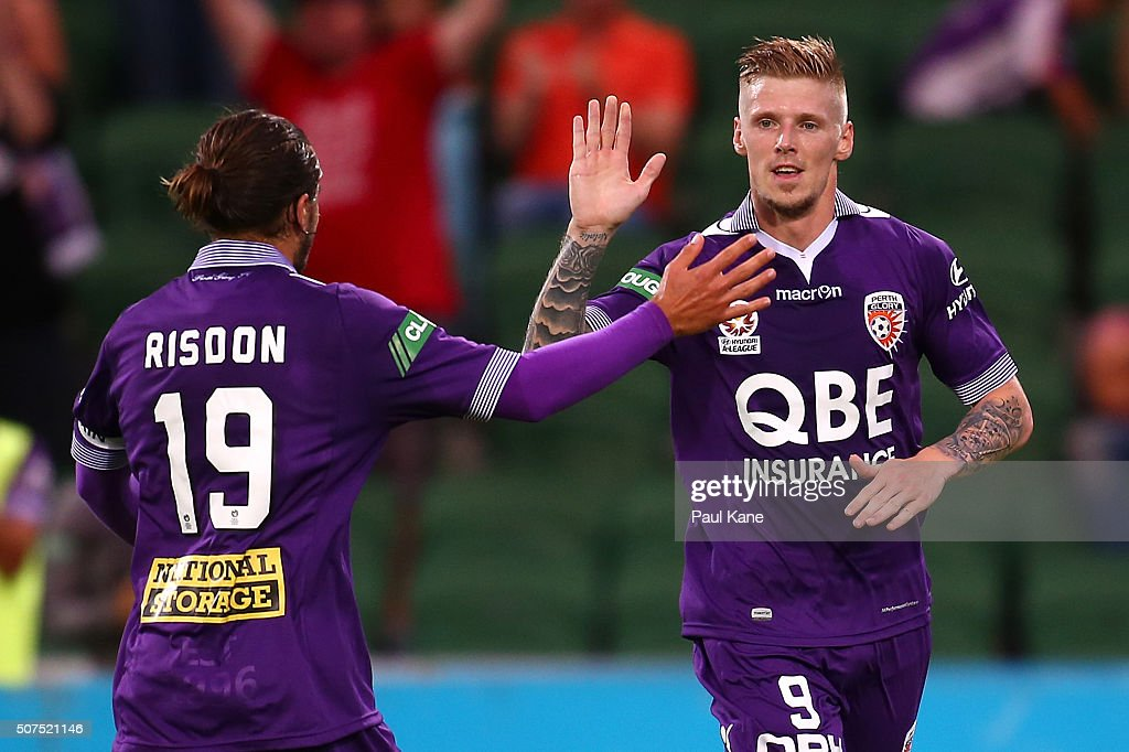 Josh Risdon and Andy Keogh of the Glory celebrate a goal during the round 17 A-League match between Perth Glory and Melbourne Victory at nib Stadium on January 30, 2016 in Perth, Australia.
