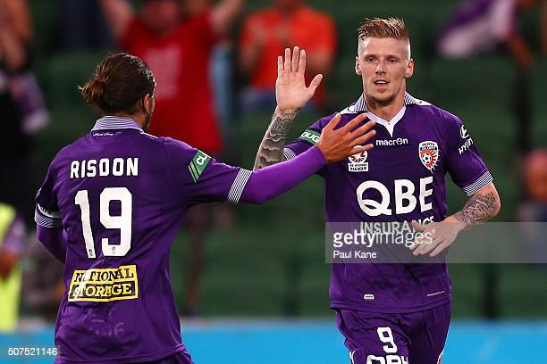 Josh Risdon and Andy Keogh of the Glory celebrate a goal during the round 17 ALeague match between Perth Glory and Melbourne Victory at nib Stadium...