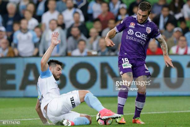 Josh Risdon of Perth Glory and Bruno Fornaroli of Melbourne City compete during the ALeague Elimination Final match between Melbourne City FC and the...