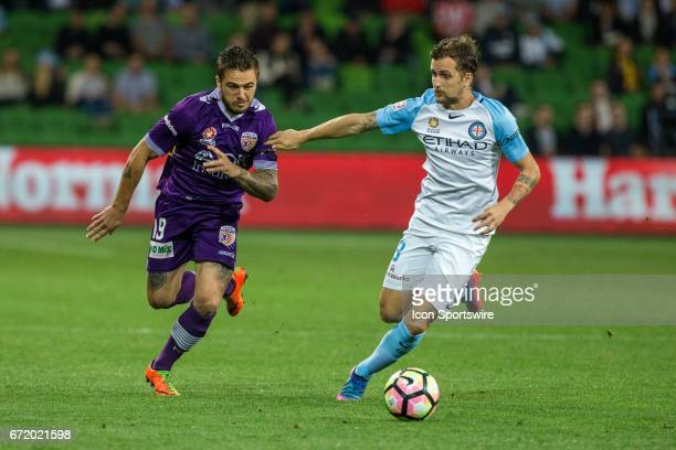 Josh Risdon of Perth Glory and Neil Kilkenny of Melbourne City contest the ball during the Elimination Round of the Hyundai ALeague Finals Series...