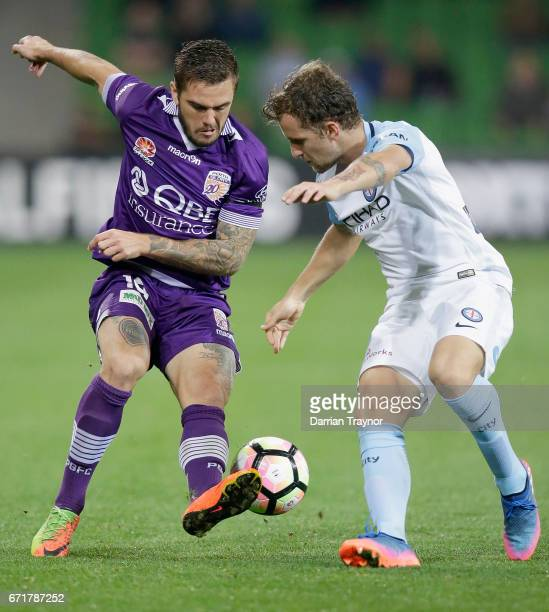 Josh Risdon of Perth Glory and Nicolas Colazo of Melbourne City compete for the ball during the ALeague Elimination Final match between Melbourne...