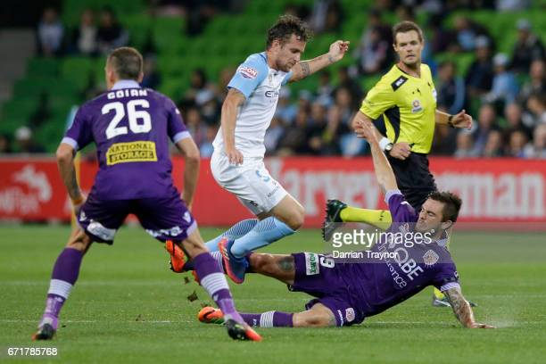 Josh Risdon of Perth Glory challenges Nicolas Colazo of Melbourne City during the ALeague Elimination Final match between Melbourne City FC and the...