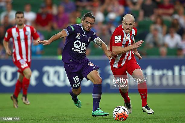 Josh Risdon of the Glory and Aaron Mooy of Melbourne contest for the ball during the round 26 ALeague match between the Perth Glory and Melbourne...