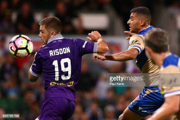 Josh Risdon of the Glory and Andrew Nabbout of the Jets contest for the ball during the round 18 ALeague match between the Perth Glory and the...
