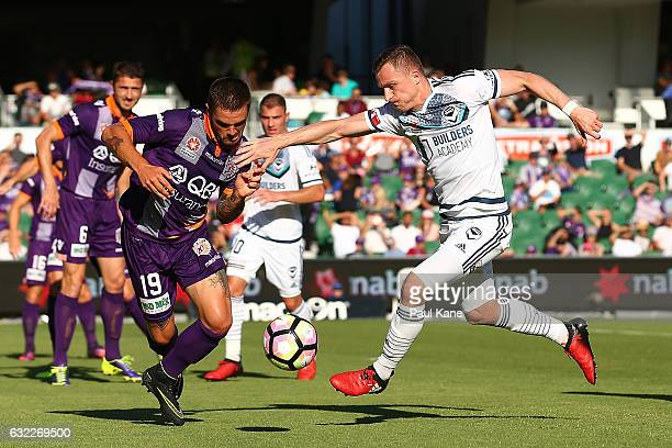 Josh Risdon of the Glory and Besart Berisha of the Victory contest for the ball during the round 16 ALeague match between Perth Glory and Melbourne...