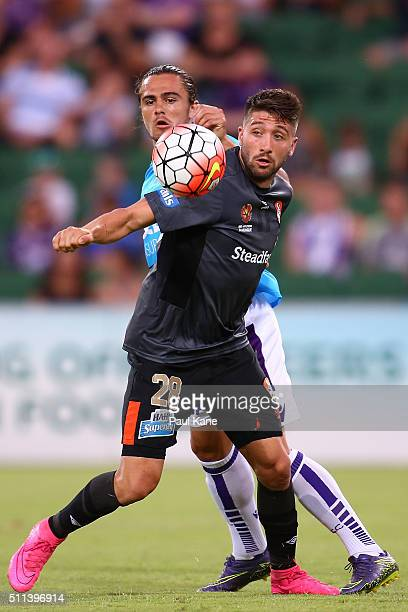 Josh Risdon of the Glory and Brandon Borello of the Roar contest for the ball during the round 20 ALeague match between the Perth GLory and Brisbane...