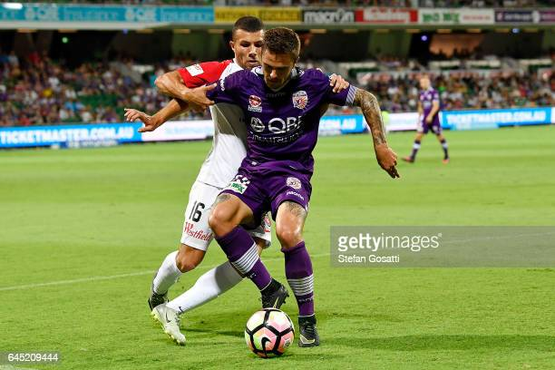 Josh Risdon of the Glory and Jaushua Sotirio of the Wanderers compete for the ball during the round 21 ALeague match between the Perth Glory and...