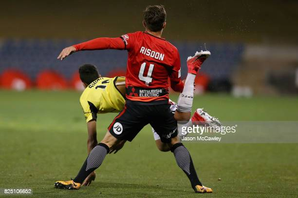 Josh Risdon of the Wanderers and Sarpreet Singh of the Phoenix compete for the ball during the FFA Cup round of 32 match between the Western Sydney...