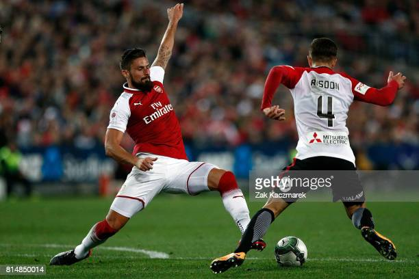 Josh Risdon of the Wanderers is challenged by Olivier Giroud of Arsenal during the match between the Western Sydney Wanderers and Arsenal FC at ANZ...