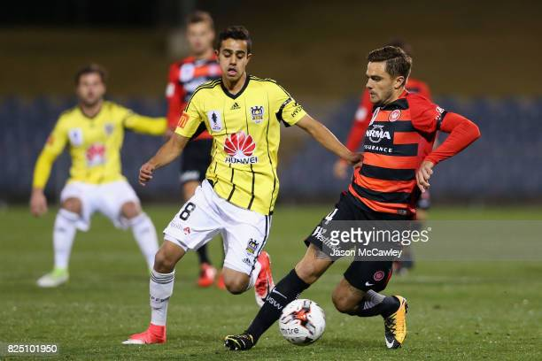 Josh Risdon of the Wanderers is challenged by Sarpreet Singh of the Phoenix during the FFA Cup round of 32 match between the Western Sydney Wanderers...