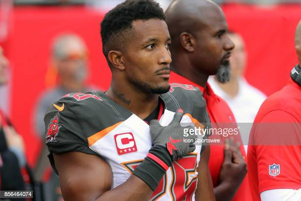 Josh Robinson of the Bucs holds his hand over his heart during the playing of the National Anthem before the NFL Regular game between the New York...