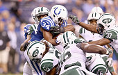 Josh Robinson of the Indianapolis Colts is tackled by the New York Jets defense during the game at Lucas Oil Stadium on September 21 2015 in...