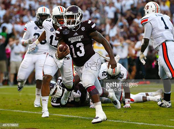 Josh Robinson of the Mississippi State Bulldogs rushes for a touchdown against the Auburn Tigers at Davis Wade Stadium on October 11 2014 in...