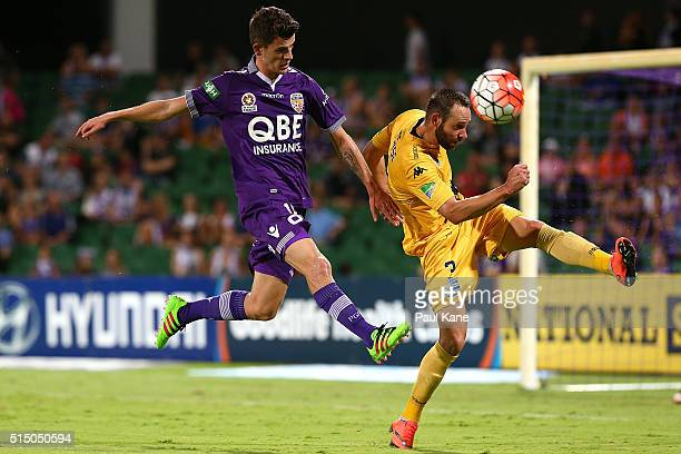 Josh Rose of the Mariners intercepts a cross against Mitchell Oxborrow of the Glory during the round 23 ALeague match between the Perth Glory and the...