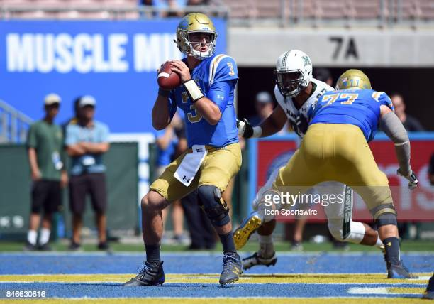 Josh Rosen drops back for a pass during a college football game between the Hawai'i Rainbow Warriors and the UCLA Bruins on September 09 2017 at the...