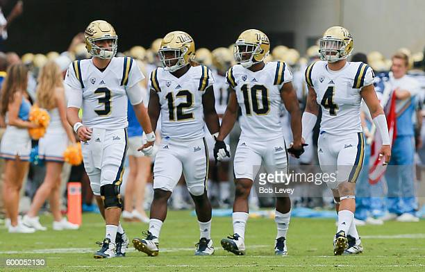 Josh Rosen of the UCLA Bruins along with Jayon Brown Kenneth Walker III and Cameron Judge take the field on September 3 2016 in College Station Texas