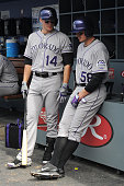Josh Rutledge and Jordan Pacheco of the Colorado Rockies talk in the dugout during the game against the Los Angeles Dodgers at Dodger Stadium on...