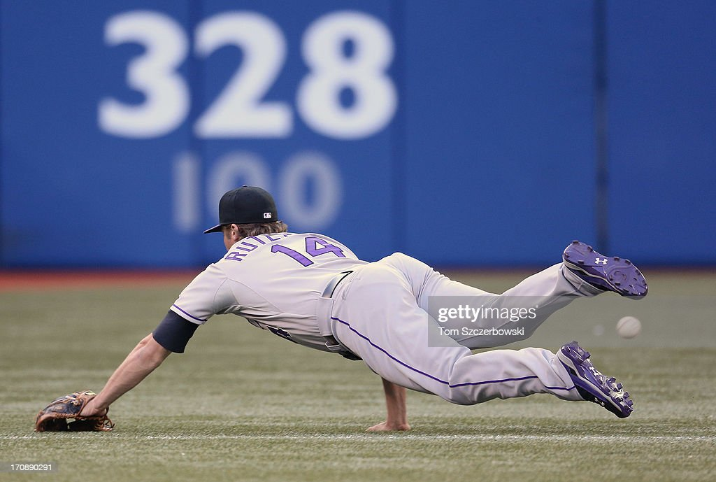 <a gi-track='captionPersonalityLinkClicked' href=/galleries/search?phrase=Josh+Rutledge&family=editorial&specificpeople=9541486 ng-click='$event.stopPropagation()'>Josh Rutledge</a> #14 of the Colorado Rockies cannot get to a single in the third inning during MLB game hit by Jose Bautsita #19 of the Toronto Blue Jays on June 19, 2013 at Rogers Centre in Toronto, Ontario, Canada.