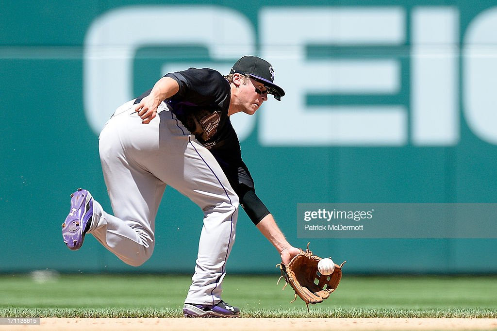 <a gi-track='captionPersonalityLinkClicked' href=/galleries/search?phrase=Josh+Rutledge&family=editorial&specificpeople=9541486 ng-click='$event.stopPropagation()'>Josh Rutledge</a> #14 of the Colorado Rockies catches a ground ball hit by Chad Tracy #18 of the Washington Nationals in the eighth inning during a game at Nationals Park on June 22, 2013 in Washington, DC.