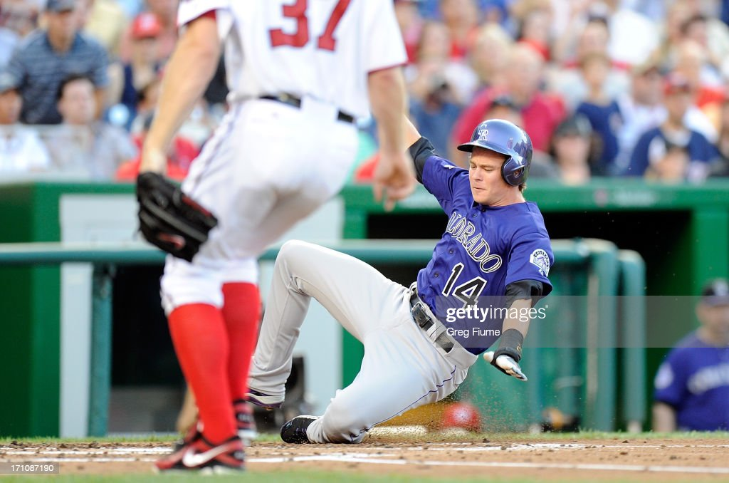<a gi-track='captionPersonalityLinkClicked' href=/galleries/search?phrase=Josh+Rutledge&family=editorial&specificpeople=9541486 ng-click='$event.stopPropagation()'>Josh Rutledge</a> #14 of the Colorado Rockies scores in the third inning against the Washington Nationals at Nationals Park on June 21, 2013 in Washington, DC.