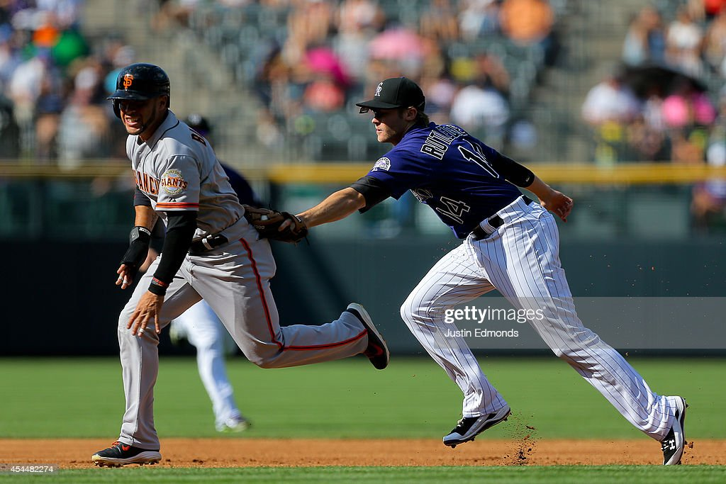 <a gi-track='captionPersonalityLinkClicked' href=/galleries/search?phrase=Josh+Rutledge&family=editorial&specificpeople=9541486 ng-click='$event.stopPropagation()'>Josh Rutledge</a> #14 of the Colorado Rockies tags out <a gi-track='captionPersonalityLinkClicked' href=/galleries/search?phrase=Gregor+Blanco&family=editorial&specificpeople=4137600 ng-click='$event.stopPropagation()'>Gregor Blanco</a> #7 of the San Francisco Giants for an out during the first inning at Coors Field on September 1, 2014 in Denver, Colorado.
