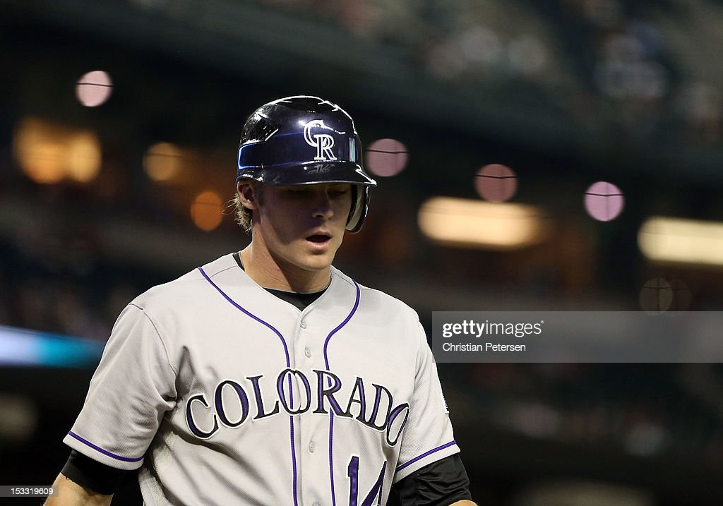 Josh Rutledge #14 of the Colorado Rockies walks to the dugout after a strike out against the Arizona Diamondbacks during the MLB game at Chase Field on October 2, 2012 in Phoenix, Arizona. The Diamondbacks defeated the Rockies 5-3.