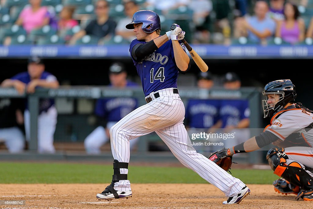<a gi-track='captionPersonalityLinkClicked' href=/galleries/search?phrase=Josh+Rutledge&family=editorial&specificpeople=9541486 ng-click='$event.stopPropagation()'>Josh Rutledge</a> #14 of the Colorado Rockies watches his RBI single that tied the game during the seventh inning against the San Francisco Giants at Coors Field on September 1, 2014 in Denver, Colorado. The Rockies defeated the Giants 10-9 on a walk-off single by Charlie Blackmon.
