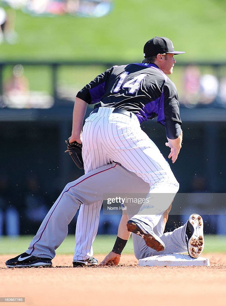 <a gi-track='captionPersonalityLinkClicked' href=/galleries/search?phrase=Josh+Rutledge&family=editorial&specificpeople=9541486 ng-click='$event.stopPropagation()'>Josh Rutledge</a> #14 turns a double play against the Texas Rangers at Salt River Field on February 25, 2013 in Scottsdale, Arizona.