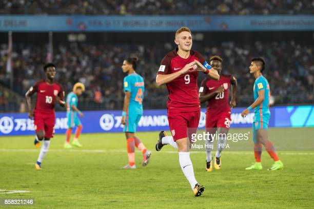 Josh Sargent of USA celebrates after scoring from the penalty spot to make it 01 during the FIFA U17 World Cup India 2017 group A match between India...