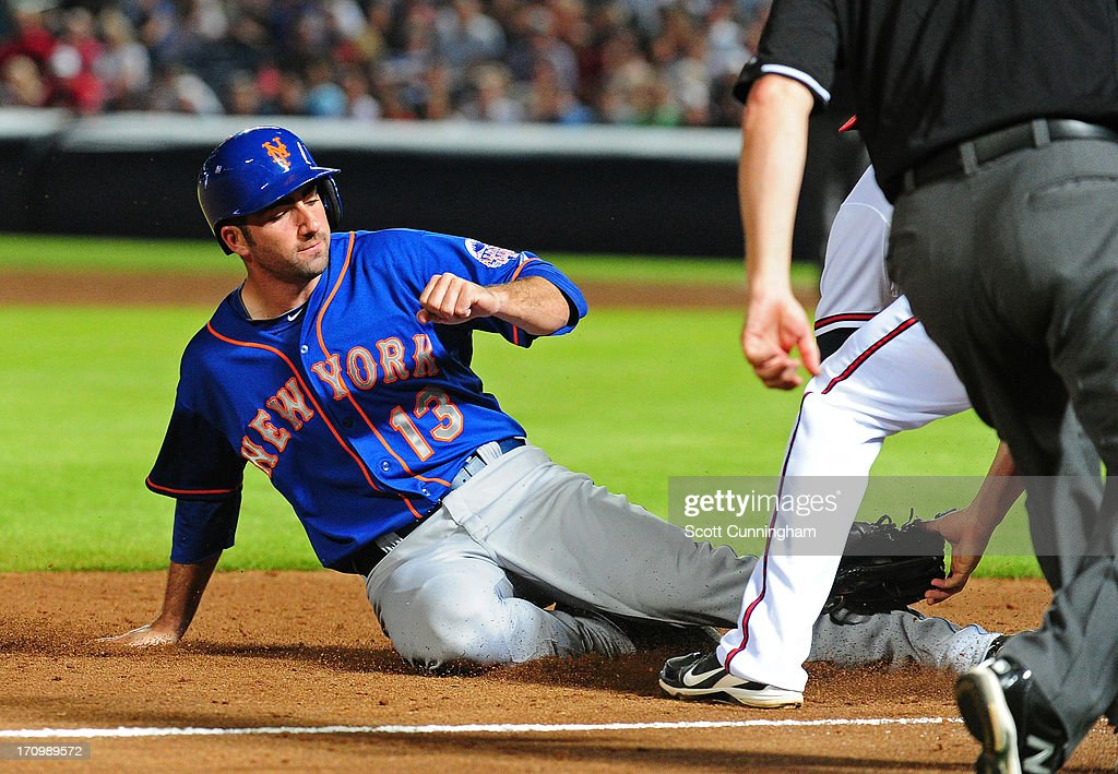 Josh Satin #13 of the New York Mets is tagged out at third base during the seventh inning against the Atlanta Braves at Turner Field on June 20, 2013 in Atlanta, Georgia.